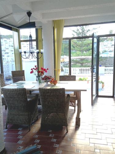The dining room is directly connected to the pool terrace