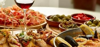 Enjoy the Spanish tapas and Paella during your holiday!