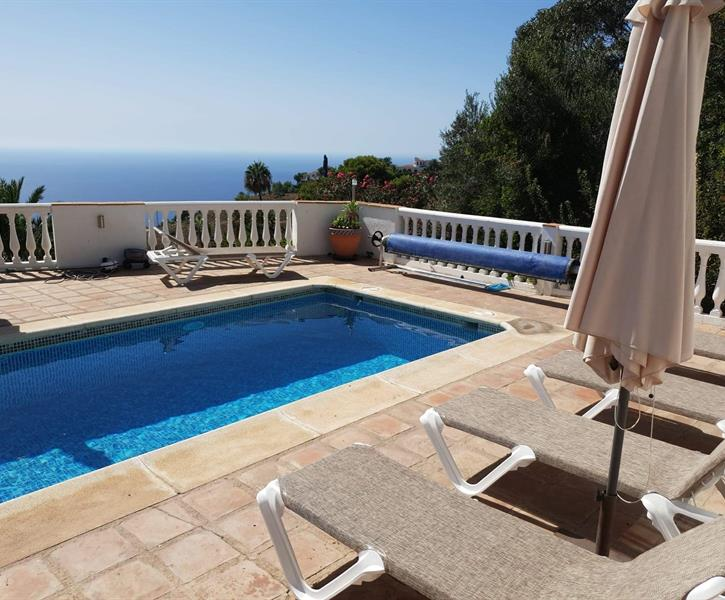 Sunny terrace, a warm pool and a  blue Meditererranean sea
