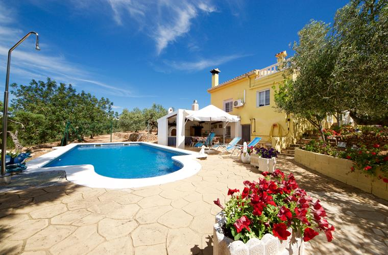 Pool, gardens and villa