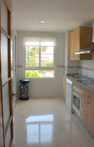 Kitchen and access to the washing room