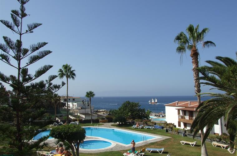 view from the balcony of the garden and main pool and sea beyond