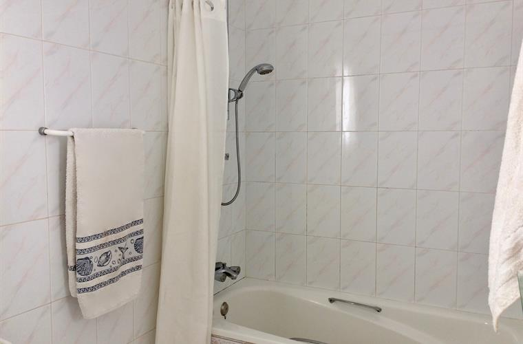 One of 2 full bathrooms - with shower/tub
