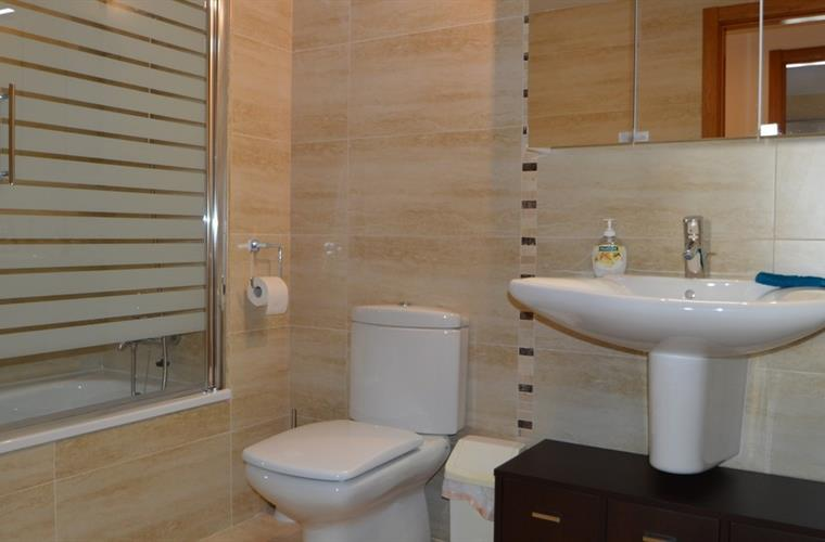 Separate bathroom with bath/shower
