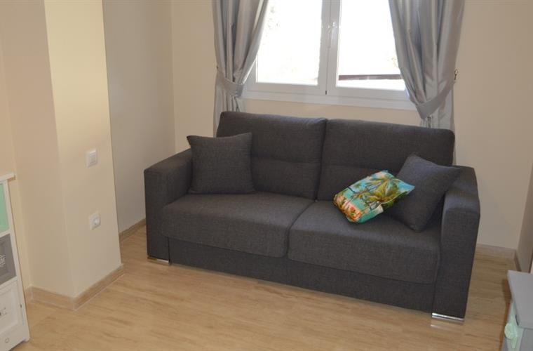 Bedroom with bed sofa