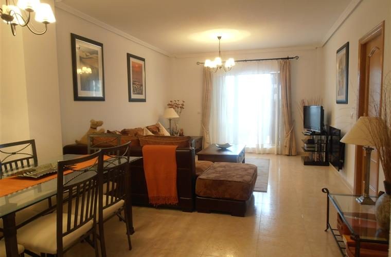 Spacious air conditioned living room and dining area.
