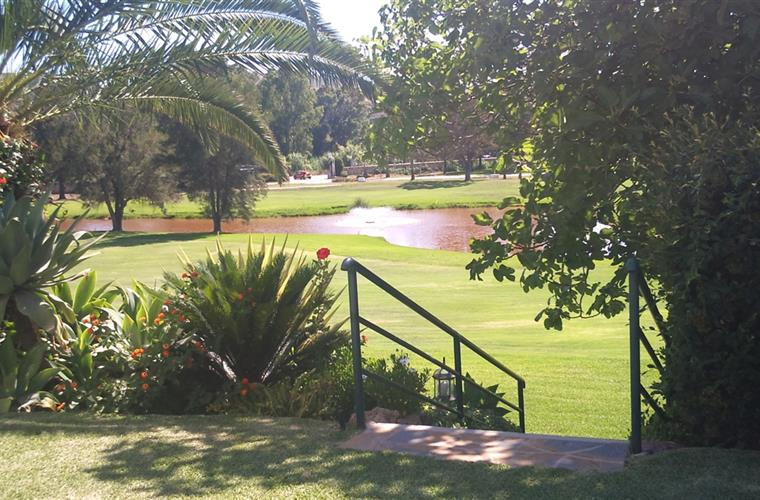 view from the pool area on to the golf course, hole V hole V