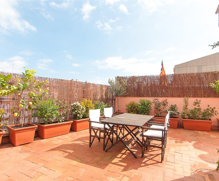 Enjoy a glass of wine on the sun-drenched private roof terrace