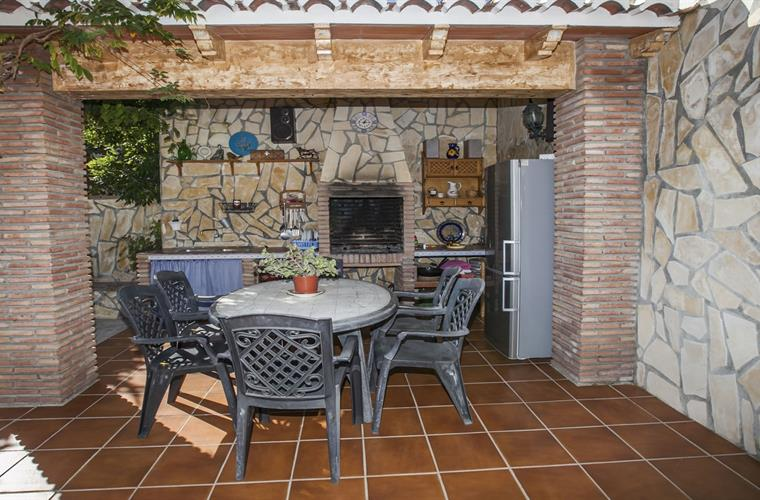 Barbecue corner with patio furniture