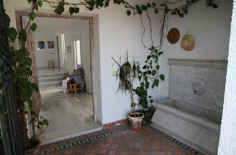 Traditional patio at entrance to the house