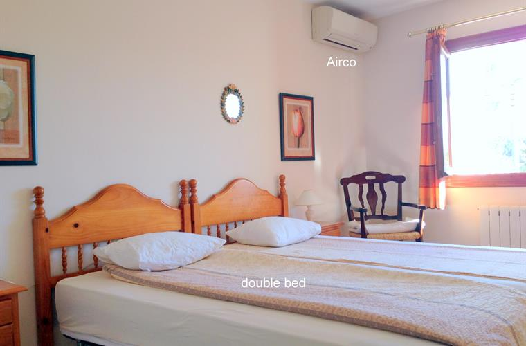 `Spacious bedroom downstairs with 2 single beds