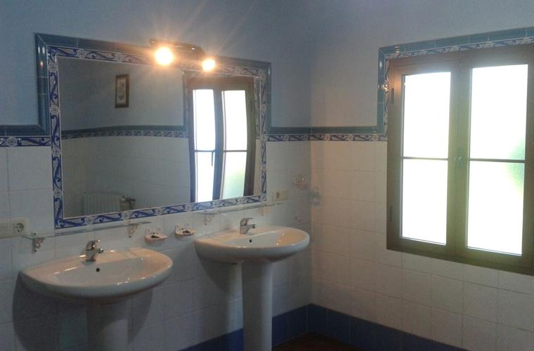 Blue bathroom and window with a nice views at the mountains