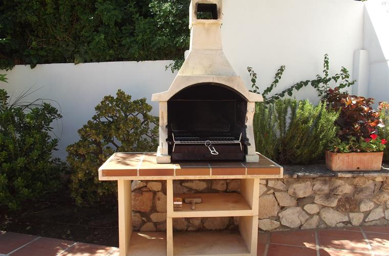 Alfresco dining with food cooked on the Andalusian BBQ