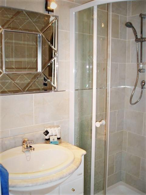 Upper level separate shower & WC