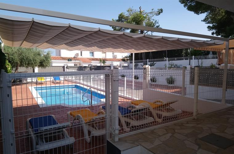 Privat and fenced pool with a big pergola