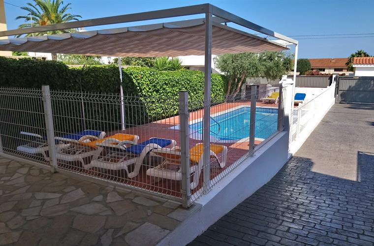 Private and fenced pool, sun loungers with a large pergola
