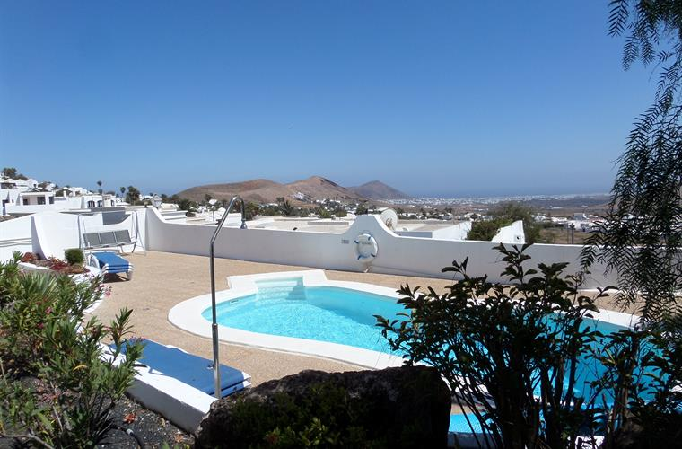 Lower terrace with pool and view towards Arrecife