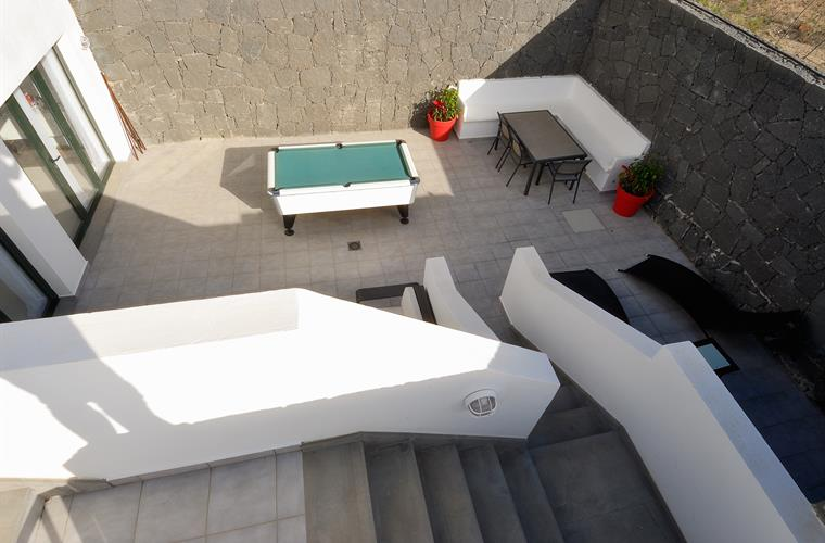 lower terrace garden with pool table