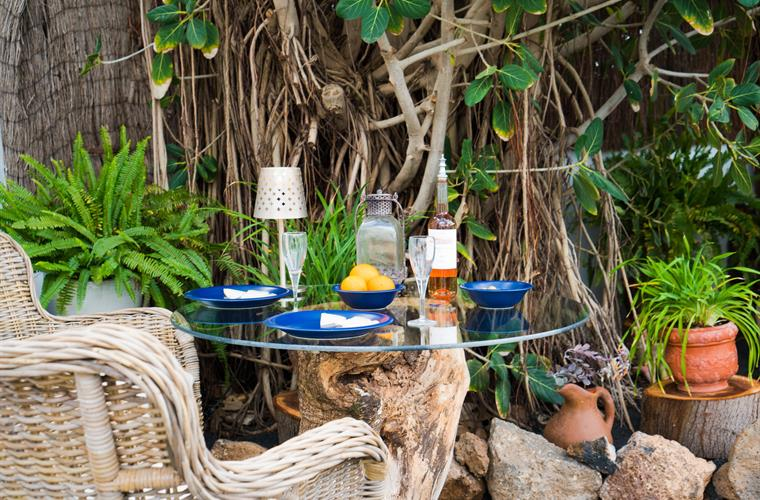 The upcycled table in front of the Banyan tree