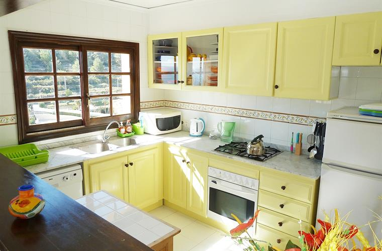 large sunny kitchen overlooking sea & almond groves.