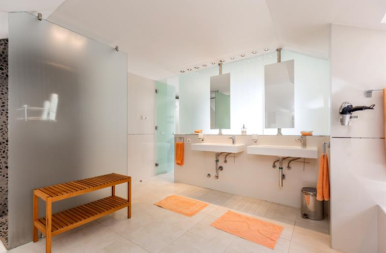 Suite bathroom with bathtub and shower to twin bedroom