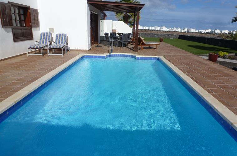 Swimming pool and large terrace with stunning coast views