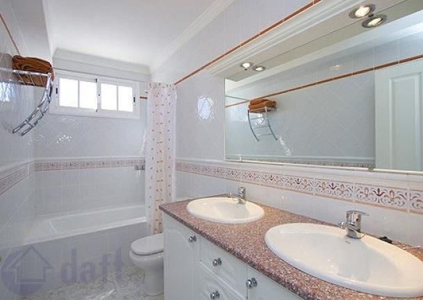 Upstairs bathroom with his and her sinks