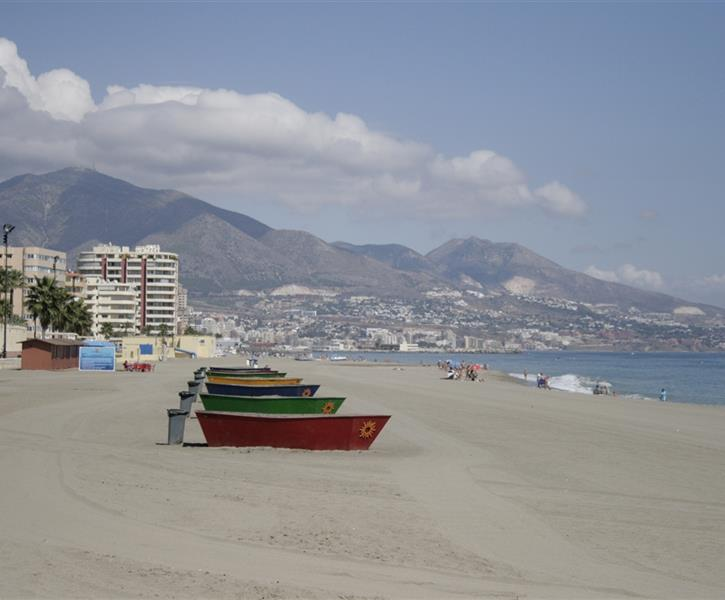 Surrounding beaches with mountain backdrop