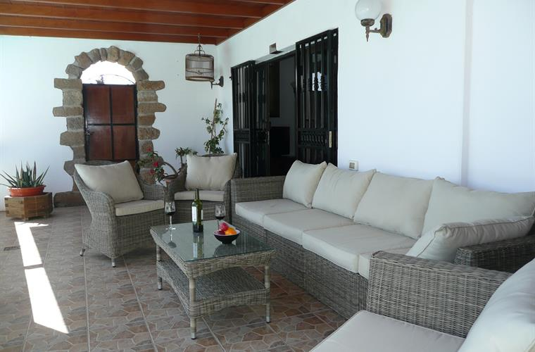 Comfortable seating on the covered terrace