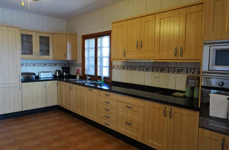 Large kitchen with all mod cons & utility alongside