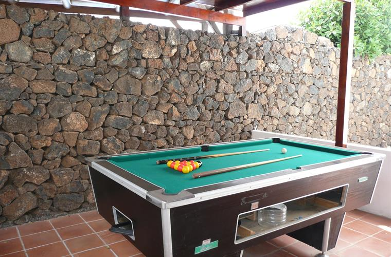 Pool table in covered area off the kitchen