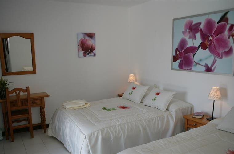 Master bedroom has one double bed and one single & door to balcony