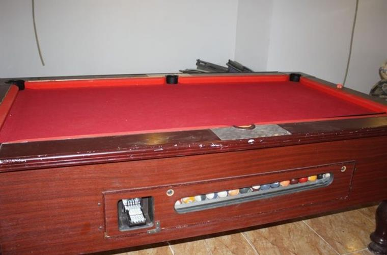 Pooltable in basement.