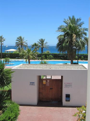 Entrance to swimming pool.  Beach bar and the sea as well.