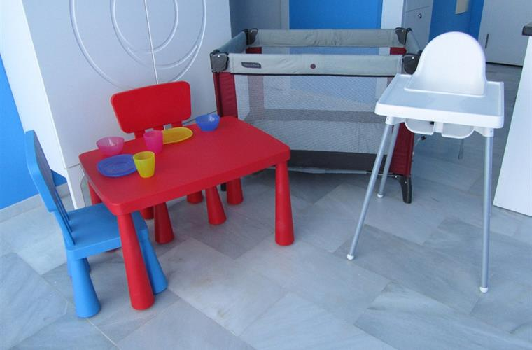 High-chair, travel cot, table and chairs supplied at no extra cost