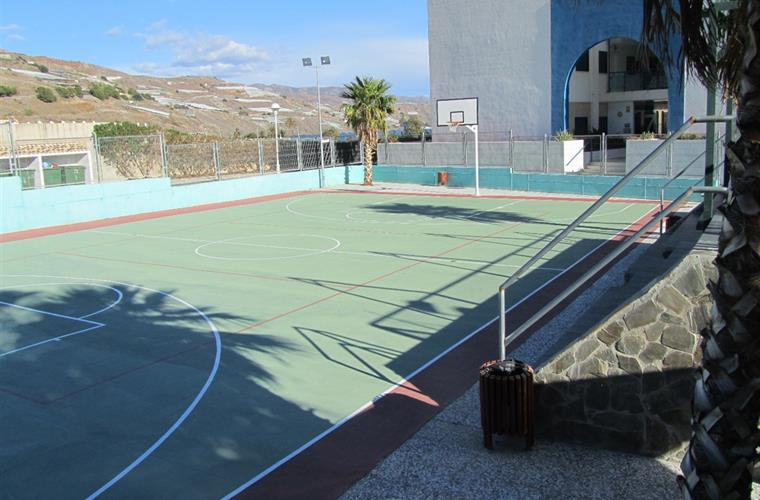Basket ball court at rear of the building