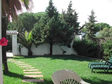 Private well cared garden with two sun loungers.
