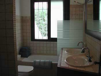 Spacious bathroom with bathtub, shower and two sinks