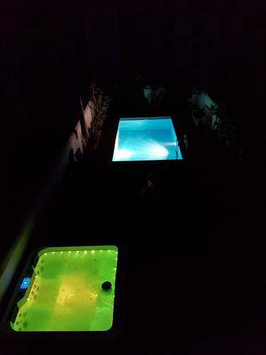 Pool and jacuzzi by night