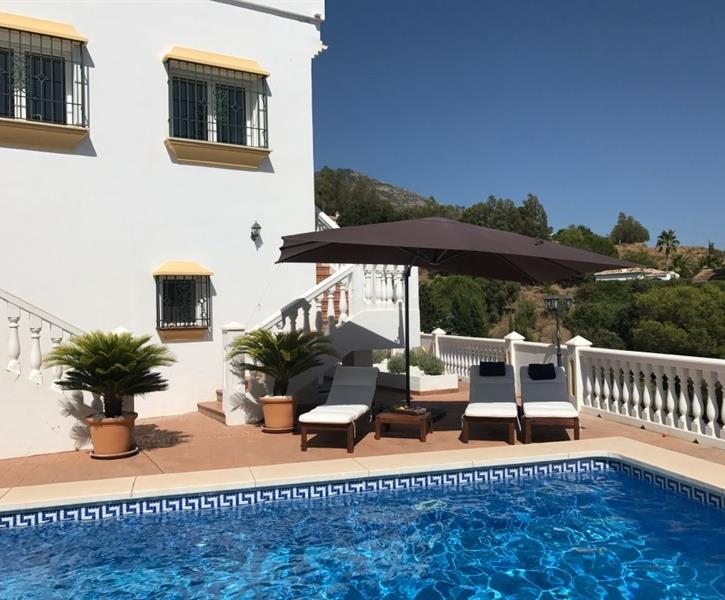 Lovely pool area with sun lounges  and shade MHH5188