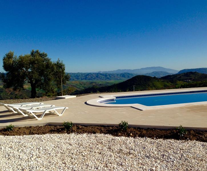 new salt water swimming pool with vieuw on the mountains.