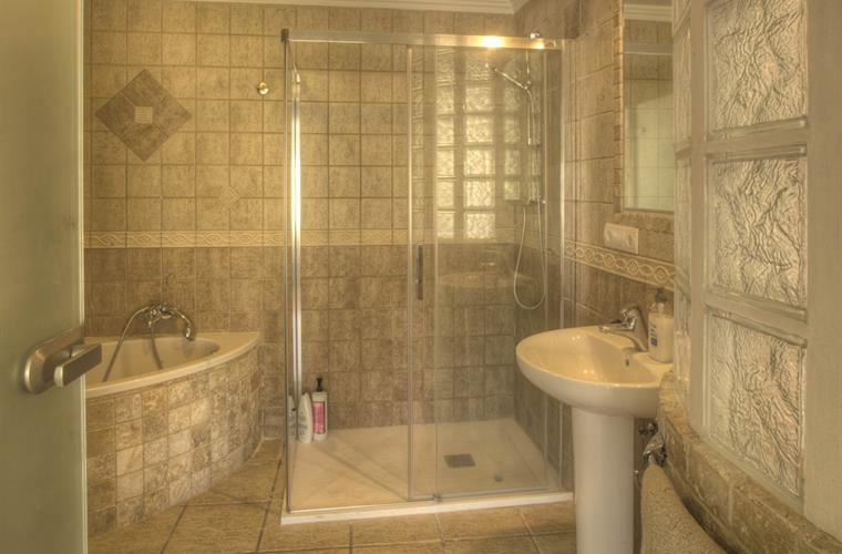 downstairs bathroom with shower and spa bath