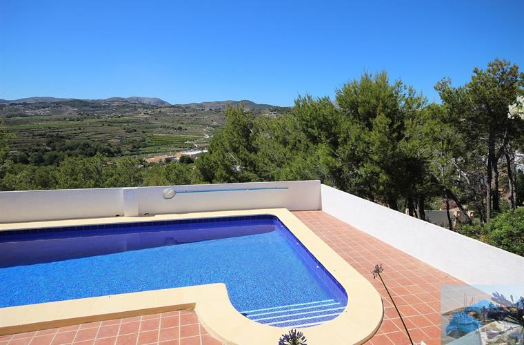 Extensive pool terrace area with great views. Sunbeds & chairs.