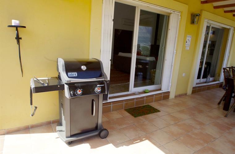 Conveniently located next to dining table: Weber Spirit gas BBQ