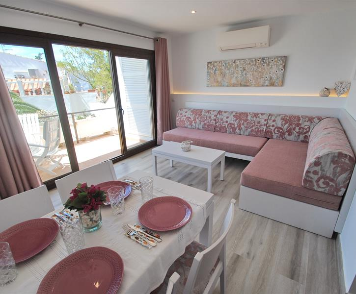 Living and dining area with access to terrace and sea views