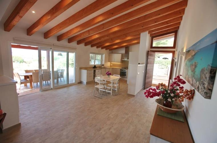 large well-equipped kitchen with great views of garden and sea