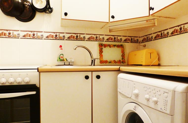 Kitchen with washing machine