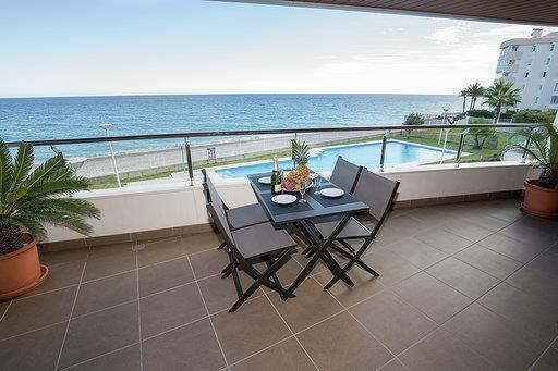 Terrace with sea and pool views