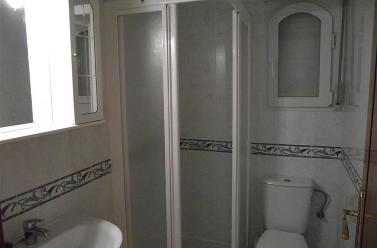 Downstairs shower room with toilet and wash basin