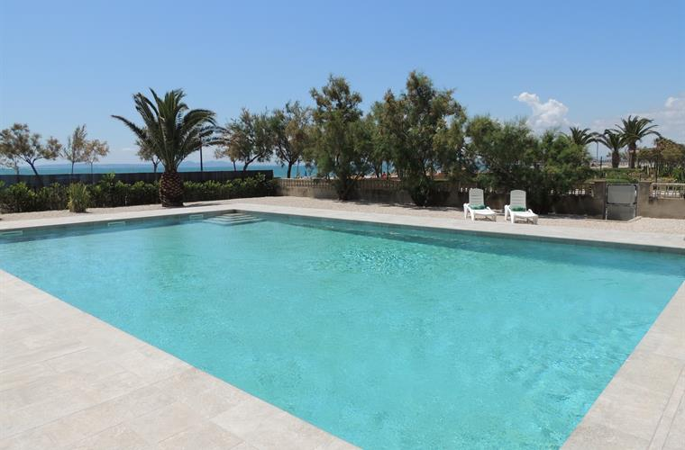 Shared Pool and direct Access to Beach Promenade and Beach
